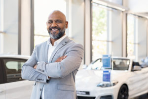 Smiling Salesman | The Payoff of Non-Commissioned Auto Sales